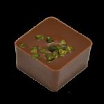 PISTACHE : Praliné aux amandes parfumé à la pistache enrobé de chocolat au lait